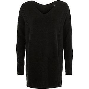 Schwarzer Pullover mit seitlichem Reißverschluss