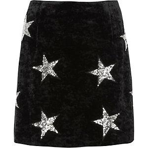 Mini jupe en velours noire motif étoile à sequins
