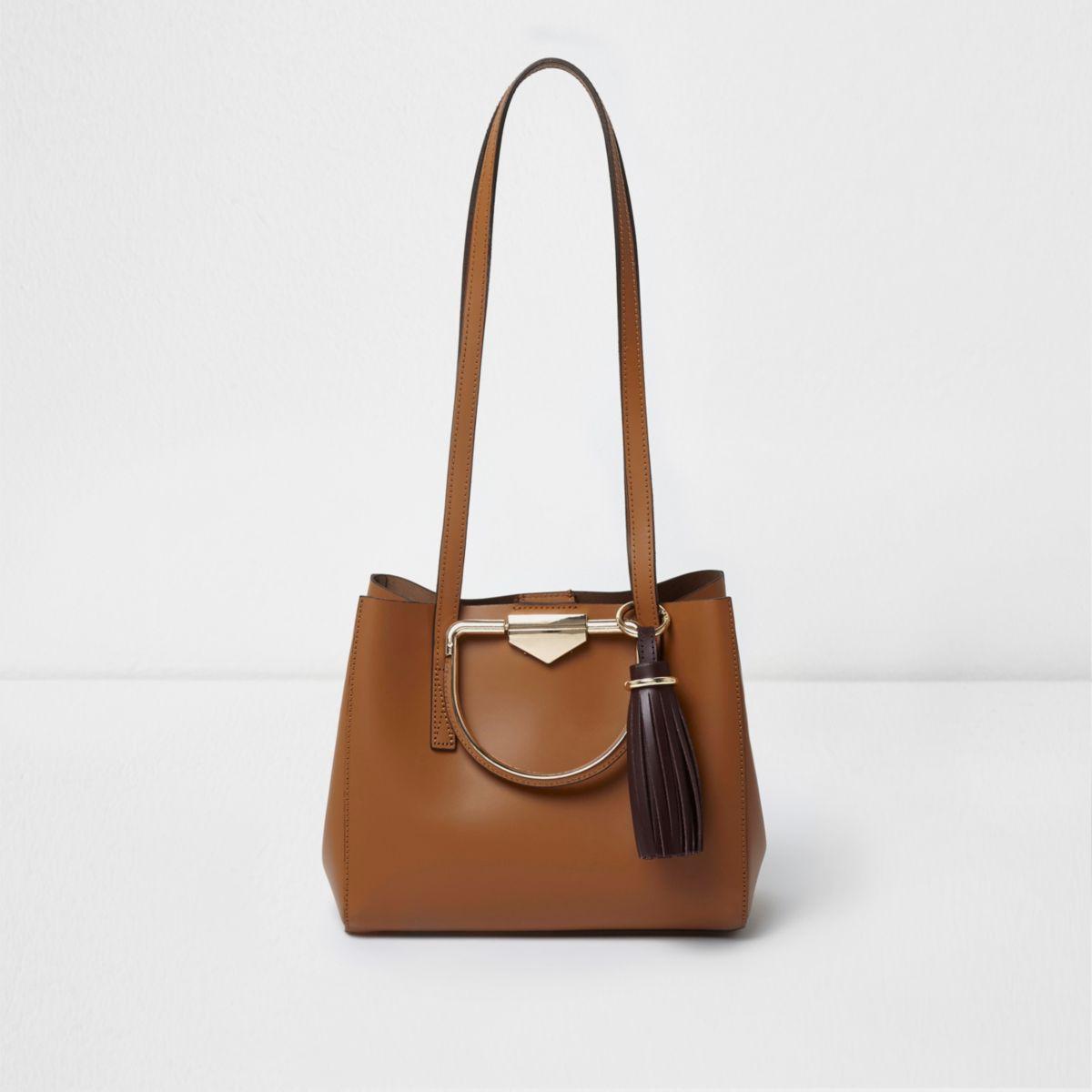 Tan leather metal handle tassel mini tote bag