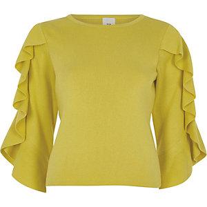 Gele gebreide top met driekwartmouwen en ruches