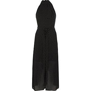 Robe mi-longue à pois noire à col montant nouée à la taille