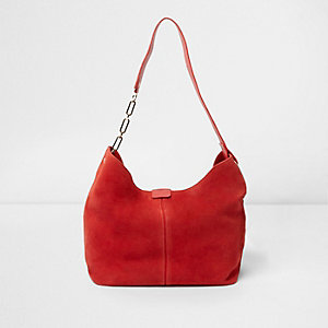 Red suede chain link handle slouch bag