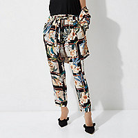 Petite green floral print tapered pants