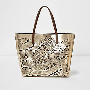 Gold metallic laser cut front leather bag