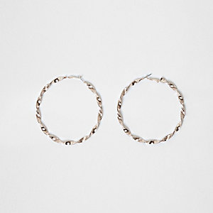 Rose gold tone twist hoop earrings