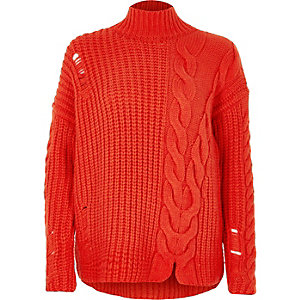 Bright red cable knit high neck sweater