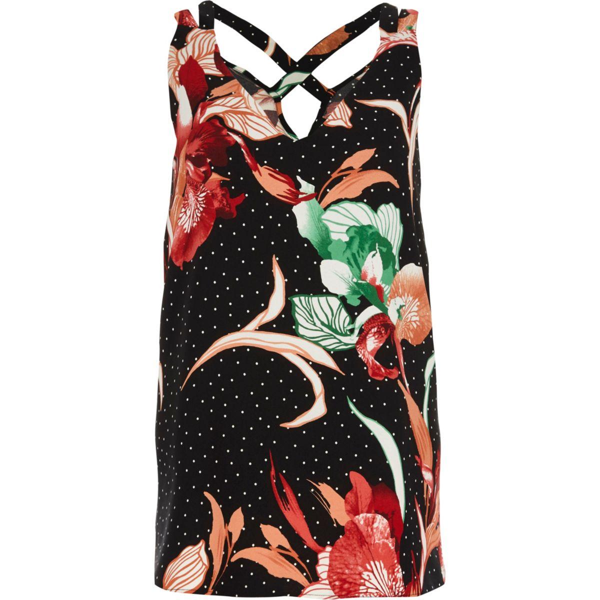 Zwart gestippeld hemdje met gekruiste bandjes op de rug en bloemenprint