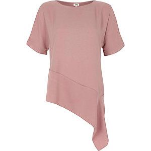 Roze T-shirt met asymmetrische zoom