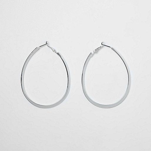 Silver tone flat bottom oval hoop earrings
