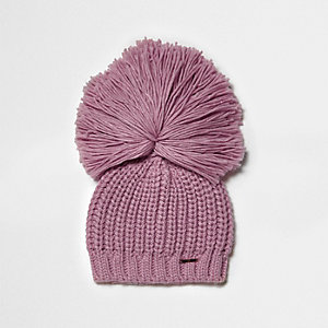 Light pink oversized pom pom beanie hat