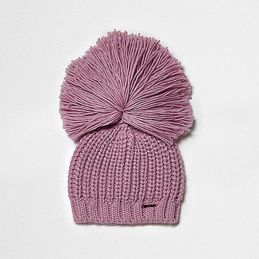 Light pink oversized pom pom beanie hat
