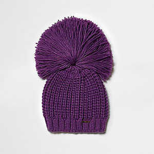 Dark purple oversized pom pom beanie hat