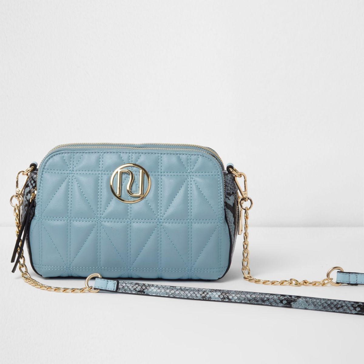 Blue quilted snakeskin crossbody bag