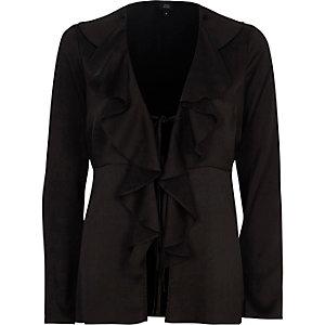 Zwarte satijnen blouse met ruches en lange mouwen met strik