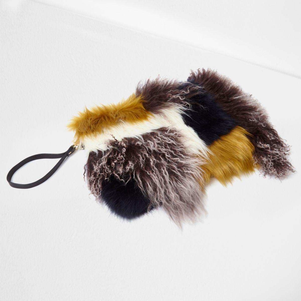 Brown mongolian wool leather clutch bag