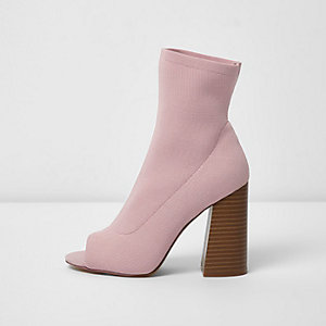 Light pink peep toe heeled knit sock boots