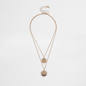 Goudkleurige ketting met twee cirkels