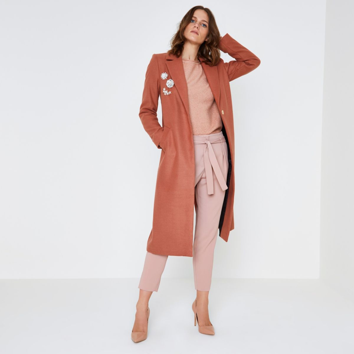 Pink brooch embellished long coat