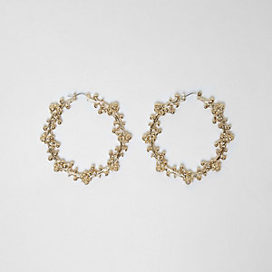 Gold tone ornate embellished hoop earrings