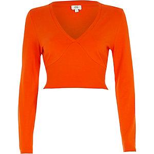 Crop Top mit langen Ärmeln und geripptem Einsatz in Orange