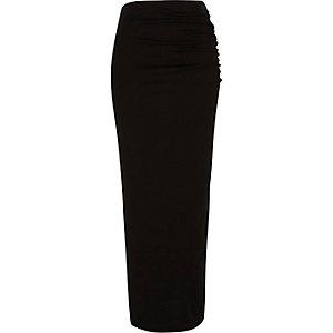 Jupe longue en jersey noire à fronces sur le côté