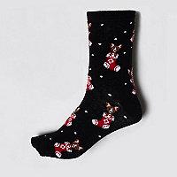 Zwarte sokken met kerstsokmotief