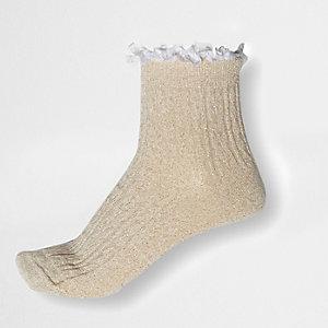 Crèmekleurige gebreide sokken met lurex-stiksels, kabelpatroon en ruches