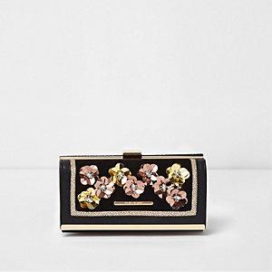 Porte-monnaie à rabat noir avec fleur métallisée en relief