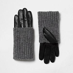 Zwarte leren handschoenen met geribbelde gebreide boorden