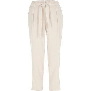 Pantalon fuselé crème noué à la taille