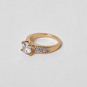 Goudkleurige ring met zirkonia en sierstenen