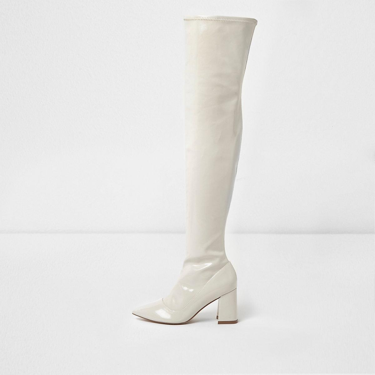 Cream patent over the knee block heel boots