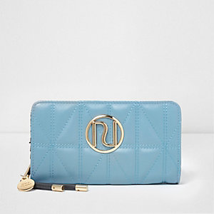 Blue quilted foldout purse