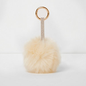 Porte-clés crème avec bride ornée de strass et pompons
