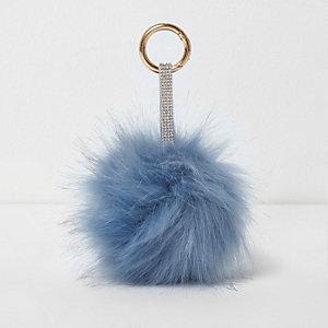 Porte-clés bleu avec bride ornée de strass et pompons