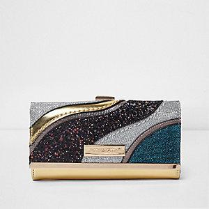 Goudkleurige glinsterende portemonnee met druksluiting en paneel