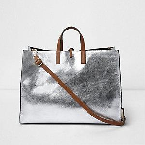 Zilverkleurig metallic tas met striksluiting