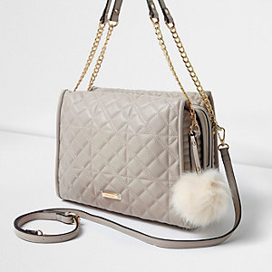 Grey quilted pom pom chain handle tote bag