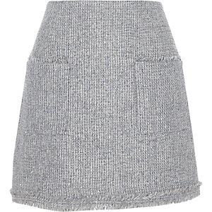 Mini-jupe trapèze en maille bouclée grise