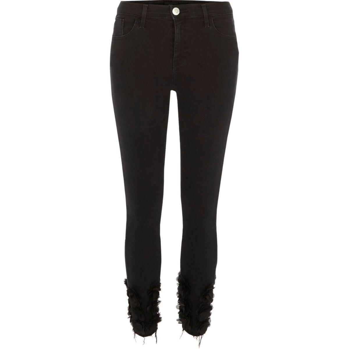 Amelie - Zwarte superskinny jeans met 3D bloemen aan de zoom