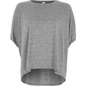 Haut en maille gris à manches courtes et cordon