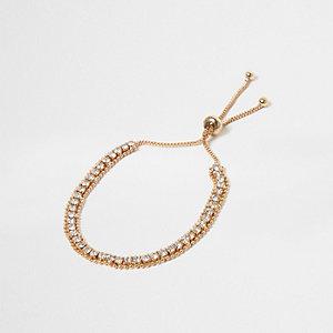Gold tone rhinestone encrusted lariat bracelet