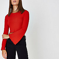 Red long bell sleeve ribbed crop top