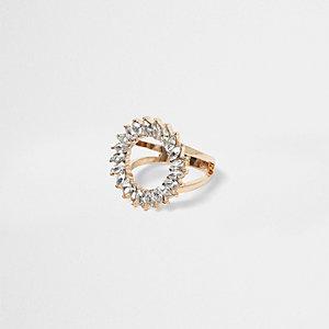 Goudkleurige ring met cirkel met siersteentjes