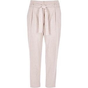 Pantalon fuselé imitation daim noué à la taille