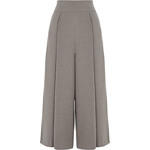 Jupe-culotte taille haute grise plissée sur le devant