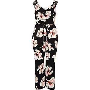 Zwarte jumpsuit met broekrok, strikceintuur en bloemenprint