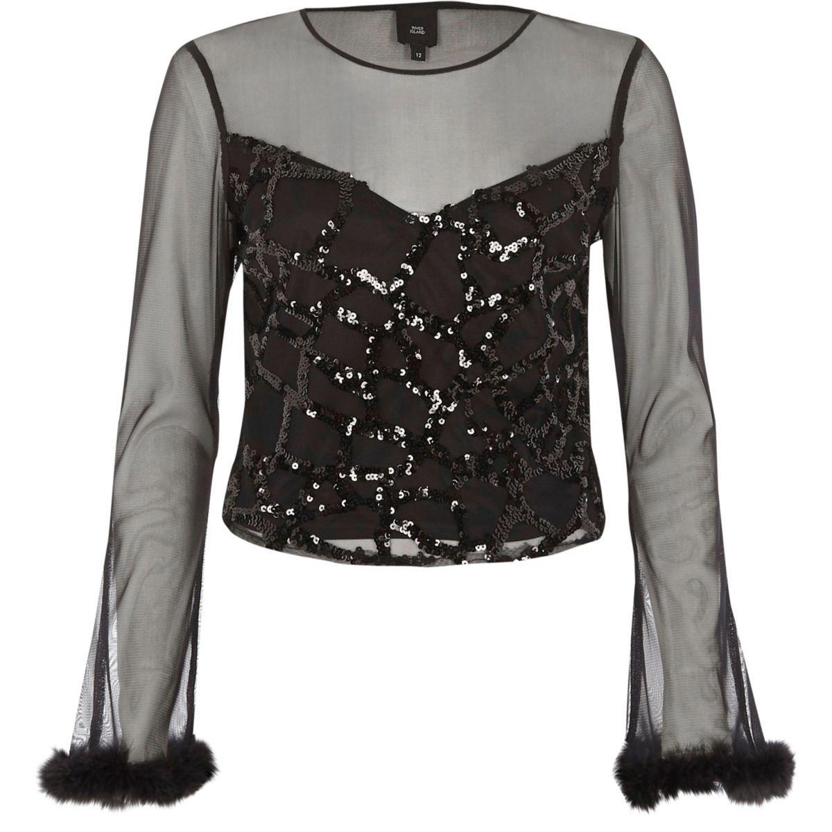 Zwarte top met lange mouwen, mesh en pailletten