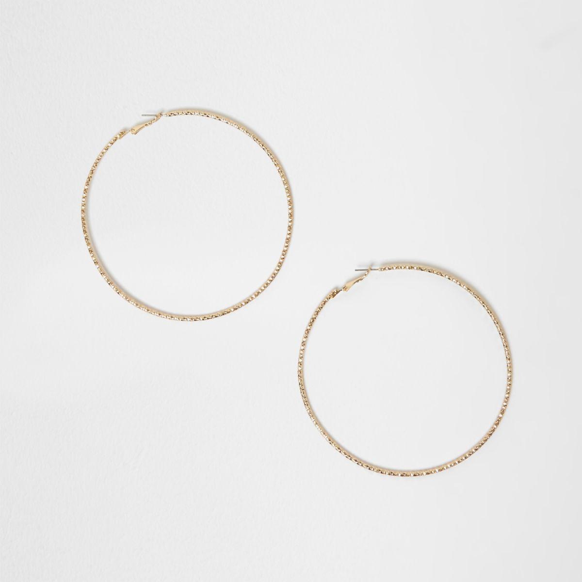Gold tone faceted oversized hoop earrings