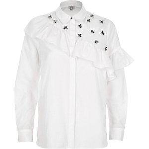 Weißes Hemd mit Schmucksteinverzierung
